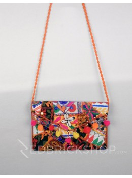 LEAF GEOMETRIC POMPOM ORANGE KUTCHI SLING BAG