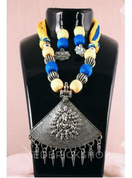 GERMAN SILVER TRIANGLE GANESH THREAD YELLOW, BLUE JEWELLERY SET
